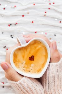Heart Shaped Coffee Cup In Hands