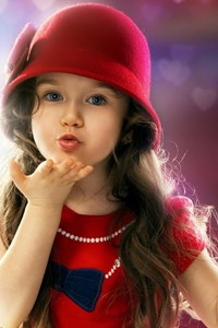 2160x3840 Little Girl Blowing a Kiss