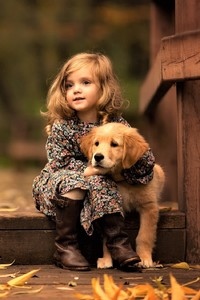 480x854 Little Girl With Golden Retriever Puppy