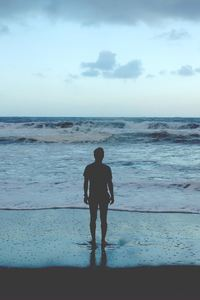 1440x2560 Man Standing At Ocean Shore