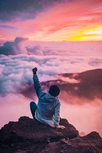 540x960 Person Sitting On Rock Looking At Sky