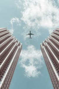 480x854 Plane Between Two Buildings 5k