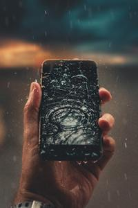 Raindrops On Phone Display In Hand Outdoors 4k