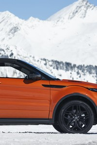 Range Rover Convertible In Snow Mountains