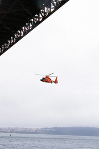 1080x1920 Rescue Helicopter Flying Under Golden Gate Bridge