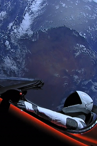 Tesla Roadster In Space With Space Suit Man