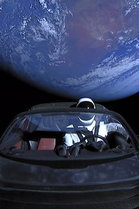 Tesla Roadster Into Space With Space Suit Man