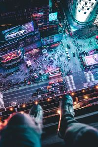 480x854 Time Square Aerial View Man Siting At Top 5k