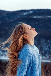 1080x2160 Windy Weather Snow Closed Eyes Girl